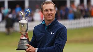 jordan speith holding winning trophy at british open at royal birkdale after beating matt kuchar in final in 2017